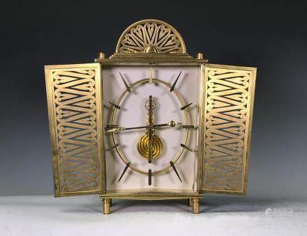 SMALL BRASS CARRIAGE SKELTON CLOCK