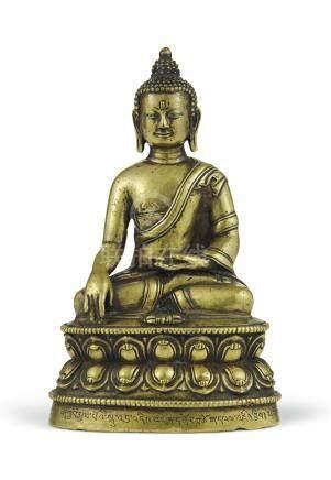A SILVER-INLAID BRONZE FIGURE OF BUDDHA SHAKYAMUNI