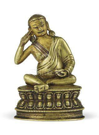 A SILVER-AND COPPER-INLAID BRONZE FIGURE OF MILAREPA