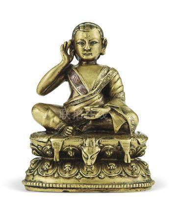 A SILVER- AND COPPER-INLAID BRONZE FIGURE OF MILAREPA