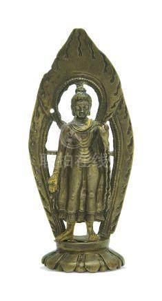 A SILVER- AND COPPER-INLAID BRONZE FIGURE OF BUDDHA SHAKYAMUNI
