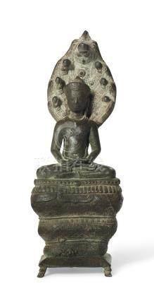 A BRONZE FIGURE OF BUDDHA MUCHALINDA