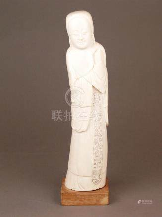 An Antique Chinese Ivory Figure of an elegant lady holding a