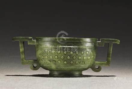AN ARCHAISTIC SPINACH-GREEN JADE GUI-FORM CENSERMING DYNASTY