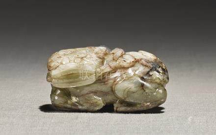 A PALE CELADON AND BROWN JADE 'BUDDHIST LION'MING DYNASTY
