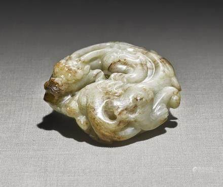 A WHITE AND RUSSET JADE 'COILED DRAGON' CARVINGYUAN - MING DYNASTY