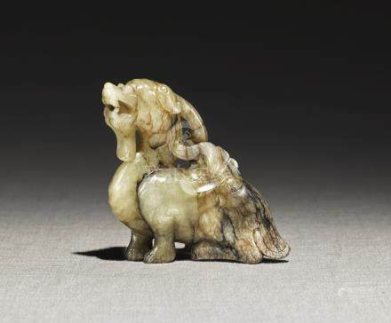 A YELLOW AND BROWN JADE 'BIXIE' CARVINGYUAN - MING DYNASTY