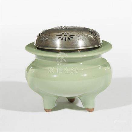 A Japanese celadon-glazed tripod censer with pierced and eng