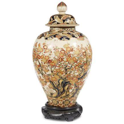 A Japanese gilt and enameled Satsuma pottery vase and cover,