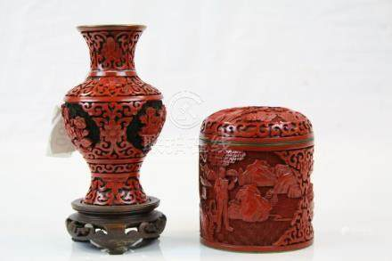 Oriental cinnabar red lacquered and enamelled vase with hardwood stand and a similar cinnabar