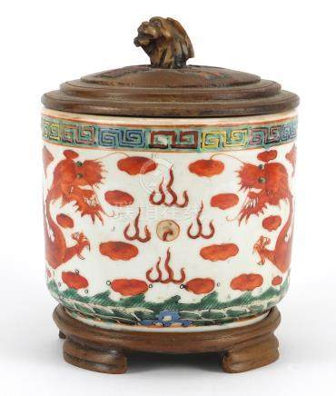 Chinese porcelain iron red brush pot with carved hardwood cover on hardwood stand, hand painted with