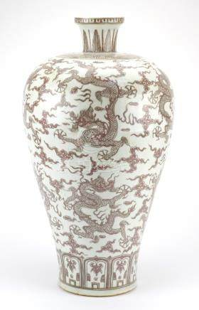 Large Chinese porcelain iron red Meiping vase, hand painted with dragons amongst clouds chasing