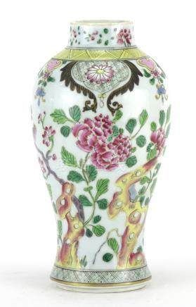 Chinese porcelain baluster vase, hand painted in the famille rose palette with birds of paradise