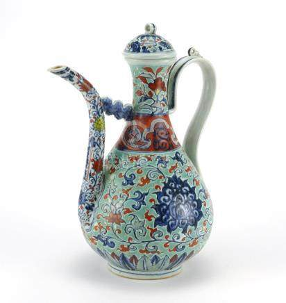Chinese porcelain wine vessel, hand painted with flower heads amongst foliate scrolls, 34cm high