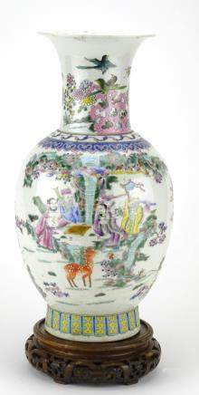 Chinese porcelain baluster vase raised on a hardwood stand, finely hand painted in the famille