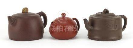 Three Chinese Yixing terracotta teapots including two naturalistic examples, each with character