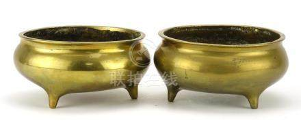 Pair of Chinese bronze tripod incense burners, each with six figure character marks to the bases,