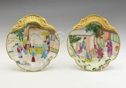 Pair of 19th Century Cantonese Famille Rose dishes of quatrefoil form, each decorated with court