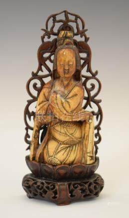 18th Century Chinese carved mammoth ivory figure of a seated deity, 11cm high on a later carved