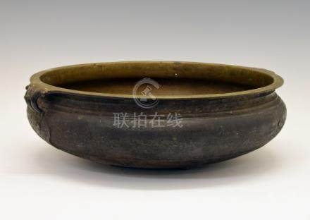 Large Chinese bronze bowl or censer having loop handles, 42cm diameter inclusive of handles