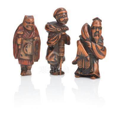 Three wooden netsuke of standing figures Meiji era (3)