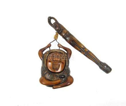 A wooden kiseruzutsu and tonkotsu, pipecase and tobacco pouch Meiji/Taisho eras (3)