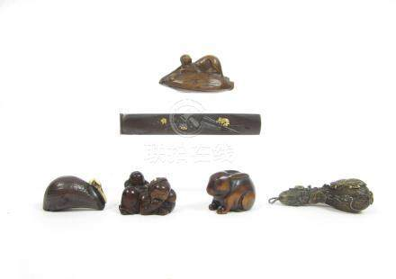 A wooden netsuke of an actor and three other netsuke Meiji era (6)