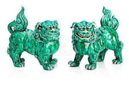 A pair of green-glazed porcelain shishi Early 20th century (2)