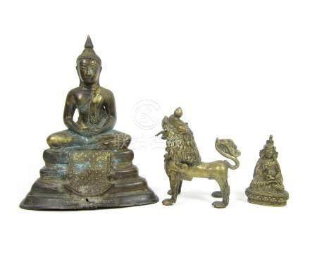A Thai bronze Buddha, a Tibetan bronze lion dog and a small bronze bodhisattva 19th century (3)