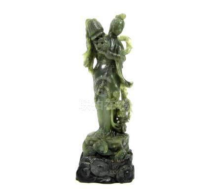 A carved soapstone figure of Lan Caihe Late 19th/early 20th century
