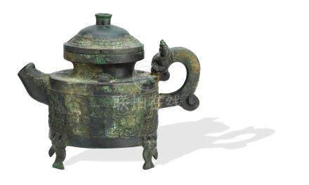 An archaistic bronze ritual pouring vessel and cover (2)