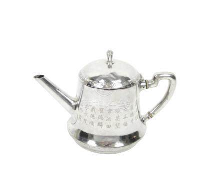 A silver teapot with hinged cover Circa 1930