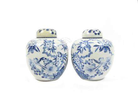 A mirrored pair of blue and white ginger jars and covers 19th century (4)