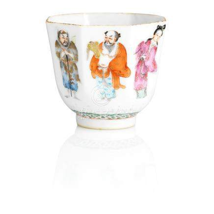 A famille rose 'Eight Immortals' wine cup Iron-red Daoguang seal mark and of the period