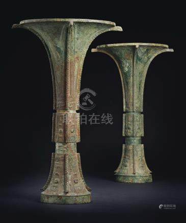 THE TIE ZHU GUA VERY RARE AND FINELY CAST PAIR OF BRONZE RITUAL WINE VESSELS