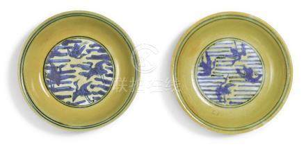 A PAIR OF UNDERGLAZE-BLUE AND YELLOW-ENAMELED 'CRANE'DISHESJIAJING MARKS AND PERIOD