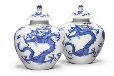 A FINE AND RARE PAIR OF BLUE AND WHITE 'DRAGON' JARLETS AND COVERSKANGXI MARKS AND PERIOD