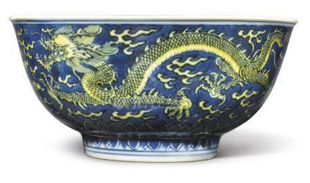 A BLUE-GROUND YELLOW-ENAMELED 'DRAGON' BOWL KANGXI MARK AND PERIOD