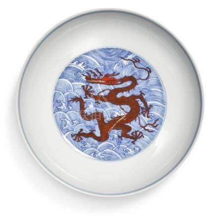 AN IRON-RED AND UNDERGLAZE-BLUE 'DRAGON' DISH QIANLONG SEAL MARK AND PERIOD
