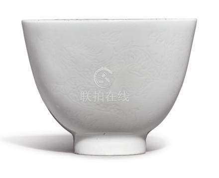 A SMALL WHITE-GLAZED ANHUA-DECORATED WINE CUP YONGZHENG MARK AND PERIOD