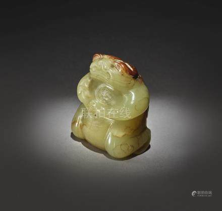 AN EXCEPTIONALLY RARE YELLOW AND RUSSET JADE FIGURE OF A MYTHICAL TOADSIX DYNASTIES