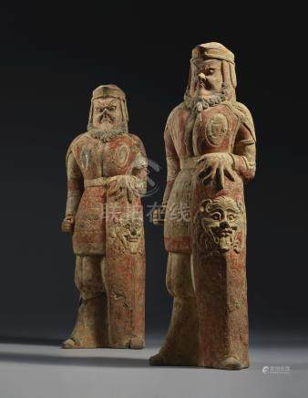 A PAIR OF PAINTED POTTERY FIGURES OF WARRIORSNORTHERN WEI DYNASTY