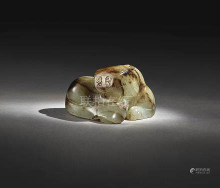 A PALE GREEN AND BROWN JADE TIGERMING DYNASTY