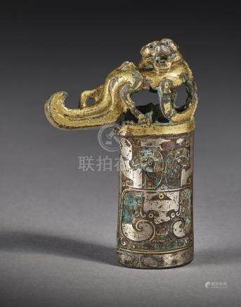 A RARE GOLD AND SILVER-INLAID BRONZE 'MYTHICAL BEAST' FINIALWARRING STATES PERIOD - HAN DYNASTY