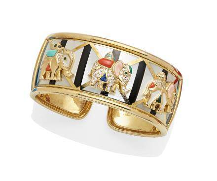 A diamond and gem-set 14k gold hinged cuff