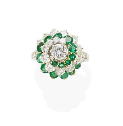 An emerald, diamond, 18k gold and platinum ring