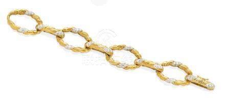 A diamond and 18k bi-color gold bracelet