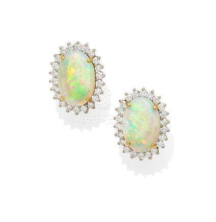 A pair of opal, diamond and bi-color gold ear clips