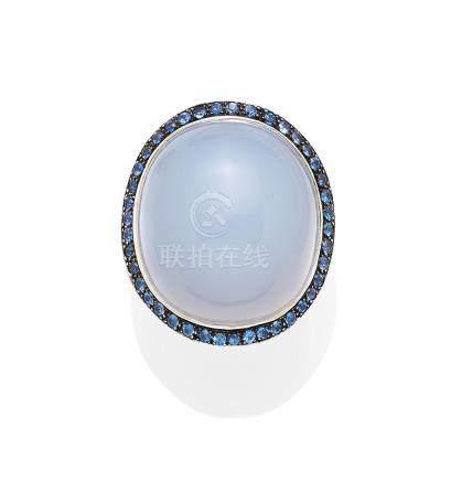 A chalcedony, sapphire, blackened 18k white ring