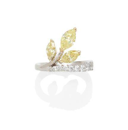 A colored diamond, diamond and 18k white gold ring